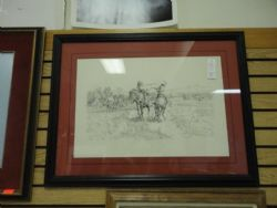 This is a print by C.M. Russell, numbered, matted and framed